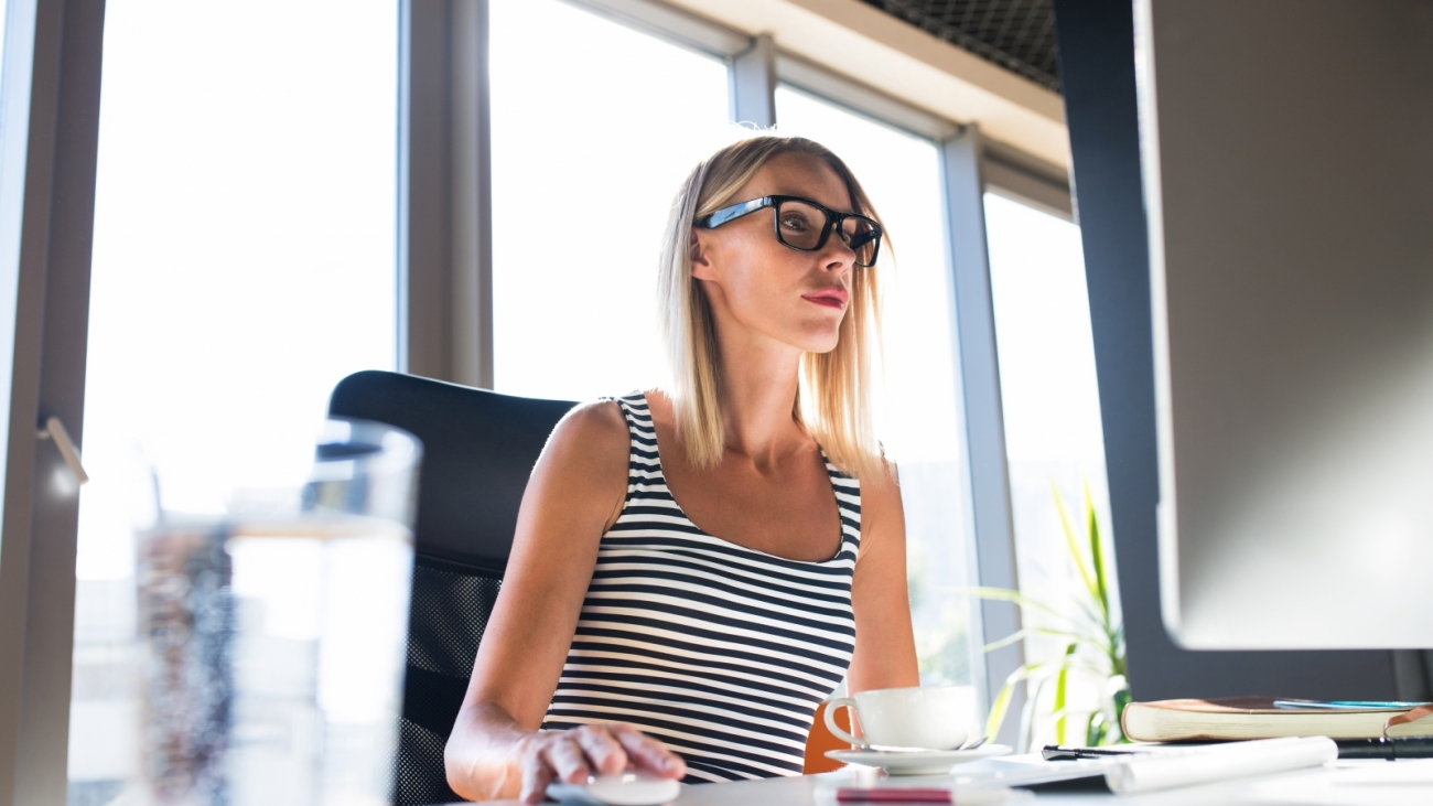 businesswoman-with-computer-in-her-office-working-PV9JHZE-1600x900